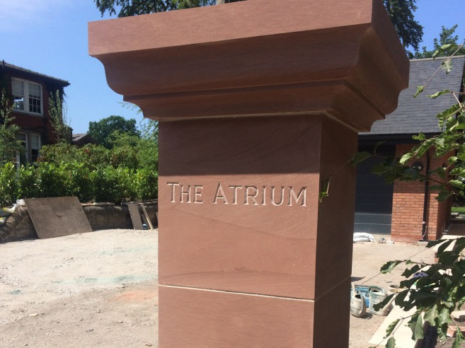 Hand carved stone house name
