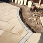 Granite sett picture frame on York stone patio in Cheshire