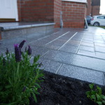 Silver granite setts, paving and bullnose step