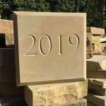 Yorkstone v-cut 2019 date stone with chamfered edge detail