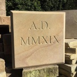 Yorkstone v-cut 2019 date stone in Roman numerals with chamfered edge detail