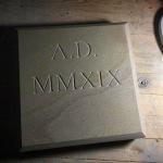V-cut Yorkstone date stone in roman numerals