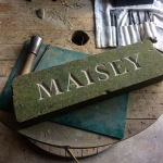 V-cut pet memorial in reclaimed Yorkstone