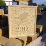 Yorkstone date stone plaque with Robin, textured background and raised border. 30cm x 45cm x 5cm