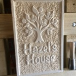 Relief carved sign for children's Nursery with a textured background, raised border and Hazel tree. 55cm x 30cm x 5cm
