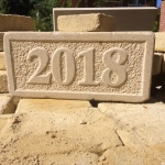 Relief carved Date stone with textured background and raised border. 40cm x 15cm x 5cm