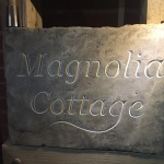 V-cut House name in reclaimed Yorkstone