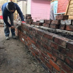 Building a reclaimed brick boundary wall in Liverpool